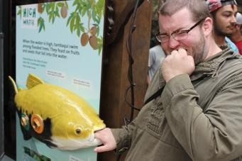 Adam being Adam in the aquarium
