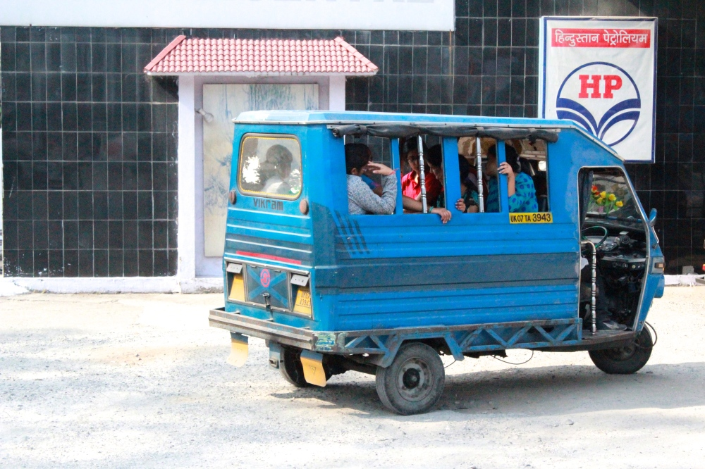 A vicram is a popular and cheaper alternative to riding an auto here. It's made for six people, but you better believe more than six Indian can manage to fit inside at a time!